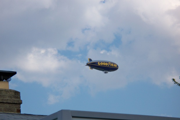 Blimp Over House