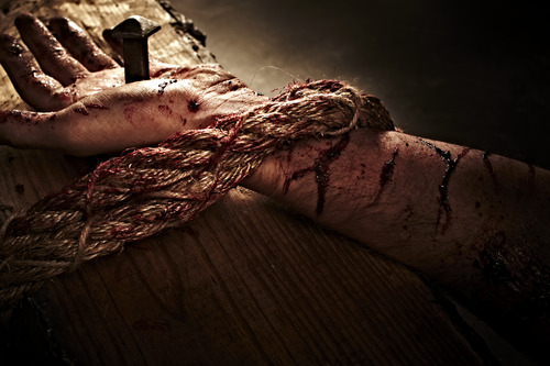 hands nailed to cross and bound my rope